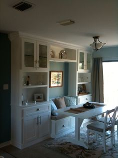 "I built these cabinets and banquette to create some much needed storage and only used 16"" of space along this wall. The rectangular table seats 6 and uses less floor space than the small round dinette."
