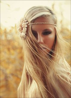 hipster headband with a flower. I'd chose a dark colored flower.