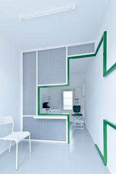 Adam Wiercinski creates denture clinic with green cross interior for Dent Protetyka