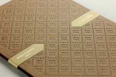 A set of highly prestigious invitations designed for 3 events to be held in one day at Cottrills prestigious retail store in Cheshire. The invitations feature a heavy blind (inkless) letterpress impression on the outer with gold print and clear foil blocked inners.