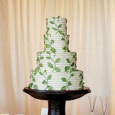 Elegant Garden Themed Wedding Cake | Delicate green vines climb the four-tiered wedding cake.