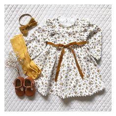 The vintage inspired 'favourite things' frock in the sweet blossoms floral and mustard velvet bow. Kids Outfits Girls, Little Girl Outfits, Little Girl Fashion, Baby Boy Outfits, Fashion Kids, Fashion Clothes, Swag Fashion, Baby Wedding Outfit Girl, Style Clothes
