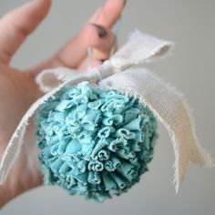 Tutorial shows you how to recycle t-shirts into darling pom pom ornaments.