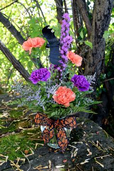 Gone Batty! Gillespie Florists, Indianapolis IN Gone Batty is a clear glass vase filled with orange carnations, purple moon carnations, purple liatris, limonium, spooky ribbon and a halloween bat! Flowers, colors and container may vary based on availability.