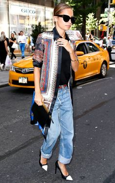 """Nicole Richie stepped out in New York City rocking a black tee, Levi's boyfriend jeans and, for a pop of color, a Givenchy scarf print jacket. She accessorized with a red Chanel belt, sunglasses and Saint Laurent's black and white pumps and """"Lutetia"""" clutch."""