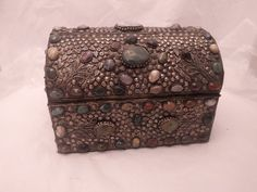 Treasure chest made from low-grade silver with semi precious stones. Created in beautiful flower pattern and silver pearls around stones. Interior is lined with navy felt-like material Measuring inches in width and 9 inches in height. Silver Trays, Treasure Chest, Silver Pearls, Art For Sale, Flower Patterns, Decorative Boxes, Mosaic Ideas, Antiques, Unique Jewelry