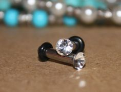 Tiny swarovski crystal stainless steel plugs / tunnels for gauges / stretched ears Sizes: 12g, 10g, 8g. $14.50, via Etsy.