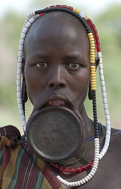 Mursi Woman by Csilla Zelko via 500px. This is the only tribe in Africa that wears these lip plates.