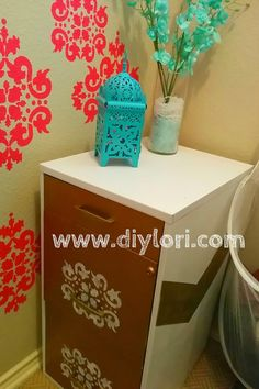 Small Laundry room Makeover! Use a small filing cabinet for storage! Over at www.diylori.com