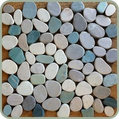 Coastal Living blue tumbled stone tile on shower floor