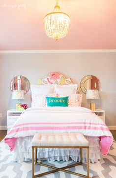 love this modern, chic girls room features gold accents and a FAB pink ceiling!