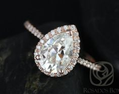 This wedding set is designed for those who love simple with a slight twist. This gorgeous pear shaped forever brilliant moissanite is sure to grab some sophisticated attention! Simple and elegant, this ring will surely be timeless!! All stones used are only premium cut, fairly traded, and/or conflict-free! Our diamonds are always natural NEVER treated or enhanced for better color or clarity. Our products are only created with the finest of recycled metals. Rosados Box™ works hard to save…