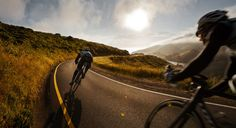Road cycling how it should be downhill, in stunning scenery, a warm wind behind you and sunset in front.
