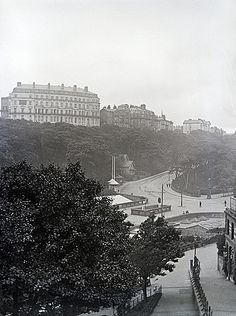 VINTAGE GLASS NEGATIVE 28 Scarborough, Yorkshire, England, UK. This is from the top of Museum Terrace, looking into the Valley. The sea front is to the right and the hill directly ahead is Ramshill Road that leads up to the South Cliff. The large white building is the Esplanade Boarding Establishment. I would date the photograph at circa 1905. This image is a low resolution version of the original negative, captured photographically rather than with a scanner.
