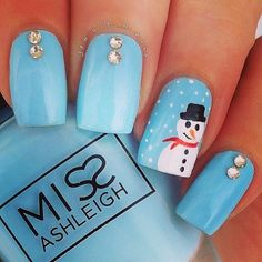 Love this Winter-y Nail Art! This little snowman is just gorgeous! Loving the pale baby blue and sparkle combo!
