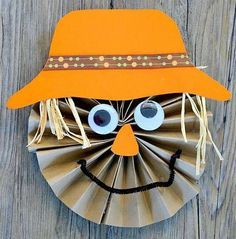 Paper Scarecrow Craft for Kids. A cute paper craft for the little ones this fall.