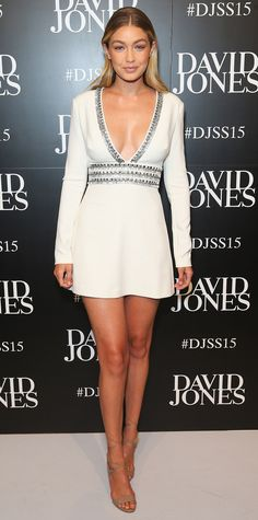 Gigi Hadid arrived at the David Jones spring/summer 2015 fashion show in Sydney in a deep-V beaded ivory LWD with nude strappy sandals.