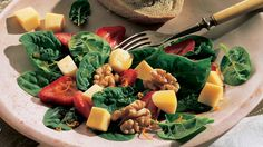 This Spinach and Strawberry Salad would be perfect with Marieke Gouda Cheese! https://www.mariekegouda.com