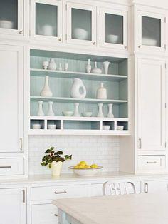 white kitchen, subway tile back splash, open shelving with wainscoting, glass cabinet doors, white ceramics