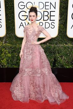 Lily Collins In Zuhair Murad Couture, Harry Winston jewelry, and Salvatore Ferragamo sandals.