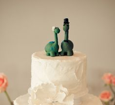 Adorable dinosaur wedding cake topper