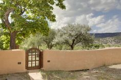 high desert garden. Love the gate and low wall!
