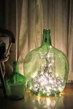 Display string lights in glass containers for a festive DIY lamp. Display string lights in glass con