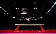 Something in the air - Heem Wei Lim of Singapore performs on the beam. #olympics #london2012