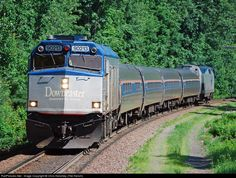 Amtrak Downeaster 682 barrels around the sweeping curve at Ballardvale with cabbage 90213 leading the way. 682 is about a half hour from reaching its destination of Boston's North Station.