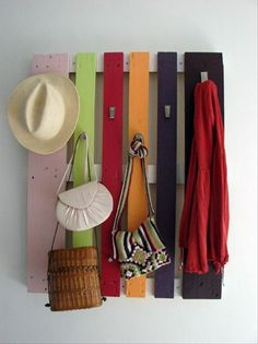 scarf/hat/coat rack made out of a pallet and painted in cute colors