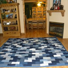 My Momma's homemade denim quilt. LOVE IT!! I love the patterns of white,med,dark.