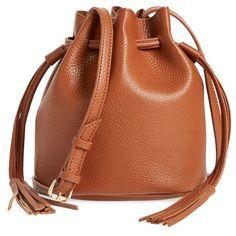Women's Street Level Mini Faux Leather Tassel Bucket Bag (245.695 IDR) ❤ liked on Polyvore featuring bags, handbags, shoulder bags, cognac, mini bucket bags, cognac purse, tassel handbag, mini shoulder bag and leather tassel purse