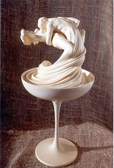 rhythm movement -- the girl's and boy's legs melt in a spinning motion inside  the cup which displays movement