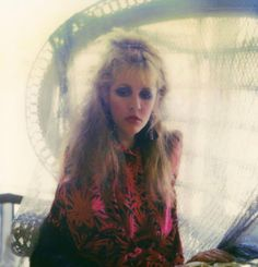 Stevie in a pensive mood, hair half up and half down, with heavily made-up eyes ~ beautiful ~ ☆♥❤♥☆