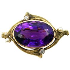 Exquisite ca. 1880s Art Nouveau Amethyst Diamond Pearl Brooch, beautifully handcrafted out of 14k yellow Gold. The amazingly well cut Amethyst, measured to weigh approx. 35 cts, exhibits a wonderful deep violet color with an incredible life and sparkle. The Amethyst is bezel set and surrounded by 4 floral shaped Gold stems, 2 of them bezel set with a bright white and sparkly white Old European -Cut Diamond and 2 set with an oriental Pearl at their ends. Each stem is finely hand... •€1,956.13