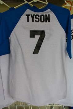 """All-Sports Party - I wanted the shirt to contain something to do with the birthday boy. I knew saying """"birthday"""" or """"Tyson"""" would cause the kids to not re-wear the shirt, so instead we chose the number #7 for the age that Tyson is turning. Then we placed each boy's name on the back of the shirt as well!"""