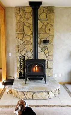 This wood stove uses Buechel Stone's Glacier River Rock for the back and risers, and Fond du Lac Steppers for the hearth pad area. Want to see more? Check out www.buechelstone.com/shoppingcart/products/Glacier-River-...