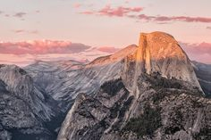 Yosemite's Half Dome in the middle of a strawberry sunset