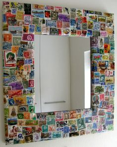 One way to use up that collection of stamps is to decoupage them onto a mirror frame.