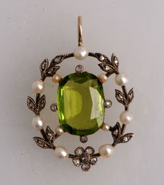 Edwardian peridot natural pearl and diamond pendant circa 1905  My birthstone never looked so pretty!!!