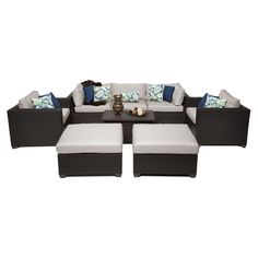 TK Classics Belle Wicker 8 Piece Patio Conversation Set with Ottoman and 2 Sets of Cushion Covers | from hayneedle.com