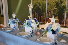 Ocean mermaid inspired table inside American Event Rentals. Perfect blue and sea party decorations!