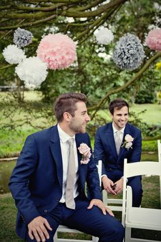 groomsmen navy suits peach - boutonnieres not so big but like the combo!