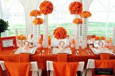 Orange flower centerpieces for an autumn theme wedding