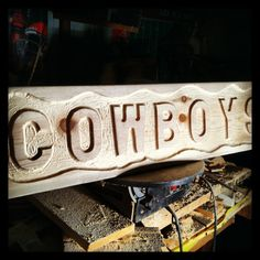 """Made this Cowboys hanging sign in my Texas wood shop.  Over 32"""" long,  I left it natural, so you can stain, or paint it any color you want.  Great for that Cowboy Man Cave.  $30.00."""