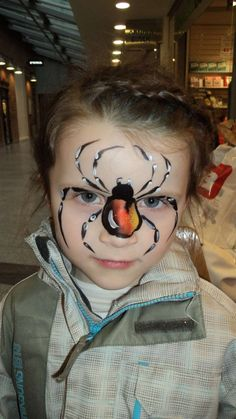 not many cute little girls get scary spiders on their faces!