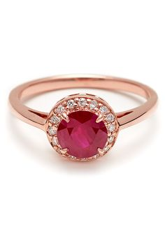 A rose gold, rose-cut ruby engagement ring with a white diamond frame by @annasheffield   Brides.com