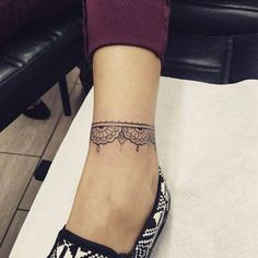 Anklet tattoo by Mr. Jones