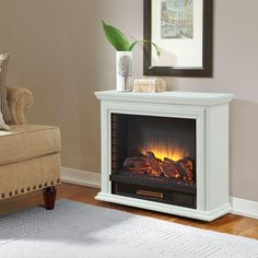 The Derry Compact Infrared Electric Fireplace from Hampton Bay provides supplemental heat with its realistic flame effect and richly finished wood veneer mantel, creating a focal point in any room. With five different temperature settings for comfort, this fireplace can be also used without the heater. Also available in Cherry.