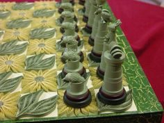 (closer-up) of Entire quilled chess set by Australian artist Licia Politis. The chess board squares and chess pieces alternate between green and gold, Australia's colors.